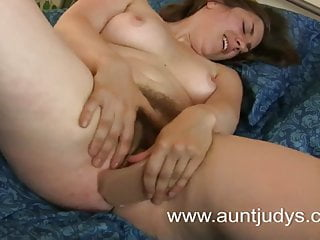 Adult babe fucks her pussy with a rubber penis