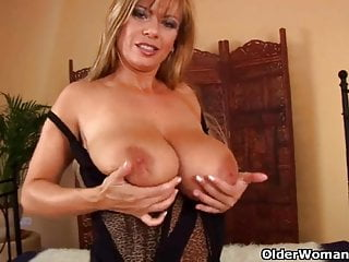 Mature lady with big tits gives her shaved pussy a over-nice