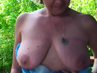 Mature shows her tits and plays with herself
