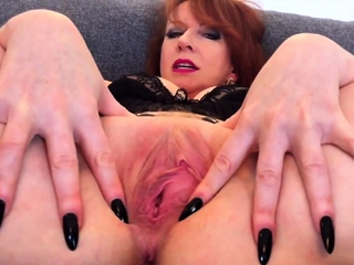 Busty mature redhead Red XXX stretches will not hear of pussy in the air