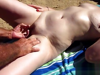 Matured wife jerking off cock greater than an obstacle beach