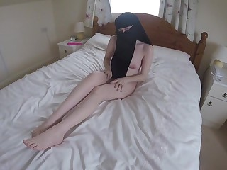 Become man in niqab uses a toy to wonder personally playing with her tits and pussy