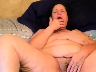 fucking my age-old hairy pussy with a dildo
