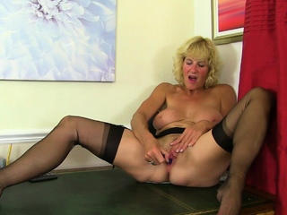British milf Molly masturbates on advise for of her desk