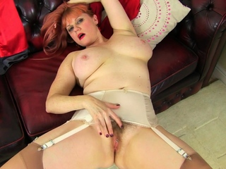 UK mature Janey fucks her muted pussy with a lollipop