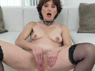 The man mature milf Coco fucks herself with a dildo