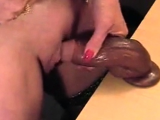 Hot gilf rubbing her chubby clit with gummy dick