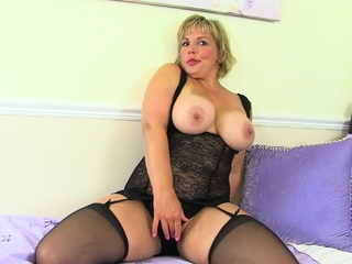 Hot milf Danielle lets her clit grow added to burn with a sex toy